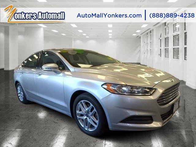 2013 Ford Fusion SE Ingot SilverCharcoal Black V4 25L Automatic 44295 miles Bold and beautifu