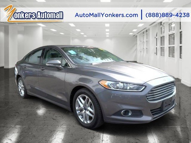 2013 Ford Fusion SE Sterling GrayCharcoal Black V4 16L Automatic 40207 miles Bluetooth satel