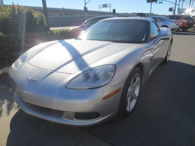 2006 Chevrolet Corvette Coupe Machine Silver MetallicEbony V8 60L Automatic 74693 miles This 2