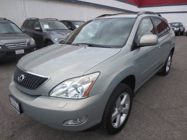 2004 Lexus RX 330 Millenium Silver MetallicIvory V6 33L Automatic 79409 miles Low Miles This 
