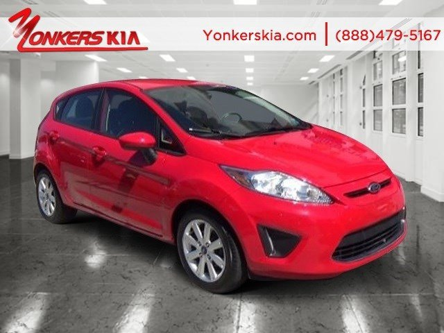 2012 Ford Fiesta SE Race RedCharcoal Black V4 16L Automatic 22500 miles Lavishly luxurious t