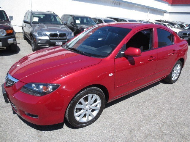 2007 Mazda Mazda3 i Touring True RedBlack V4 20L Automatic 43648 miles Here is The PERFECT CAR