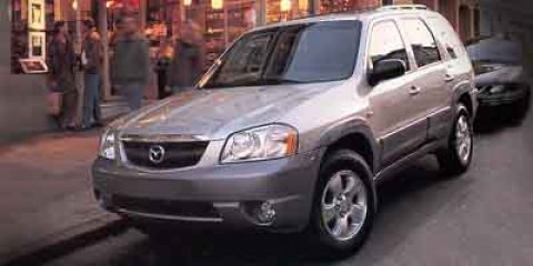 2002 Mazda Tribute L True Blue V6 30L Automatic 204455 miles  Four Wheel Drive  Power Steerin