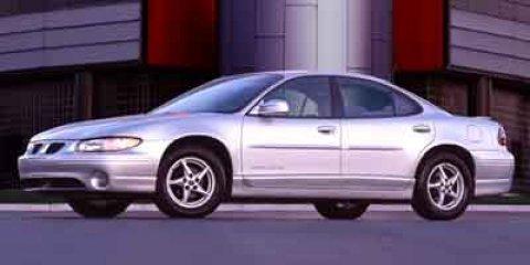 2003 Pontiac Grand Prix GT Ivory White V6 38L Automatic 104747 miles  Front Wheel Drive  Tire
