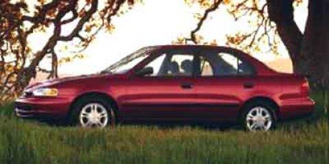 2000 Chevrolet Prizm Beige V4 18L  144012 miles The Sales Staff at Mac Haik Ford Lincoln striv