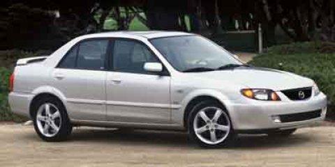 2003 Mazda Protege ES Sunlight Silver Metallic V4 20L  118823 miles  Front Wheel Drive  Tire