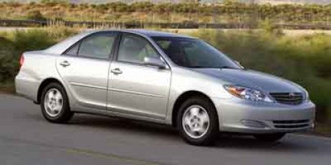 2004 Toyota Camry LE Blue V6 30L Automatic 238436 miles Scores 29 Highway MPG and 21 City MPG