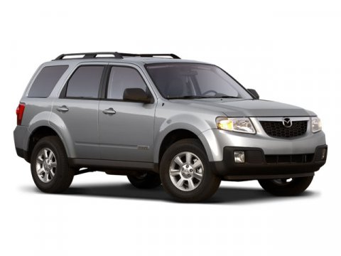 2008 Mazda Tribute Touring Gray V4 23L Automatic 31462 miles  Front Wheel Drive  Traction Con