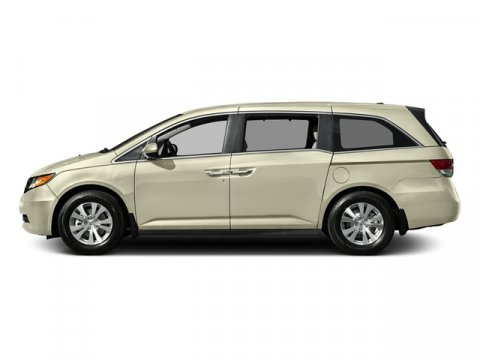 2016 Honda Odyssey SE White Diamond PearlBeige V6 35 L Automatic 31 miles  Front Wheel Drive