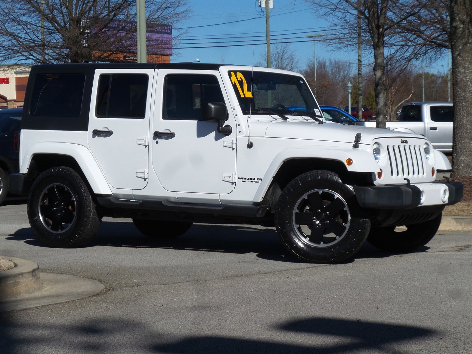 Pre-Owned 2012 Jeep Wrangler Unlimited Altitude