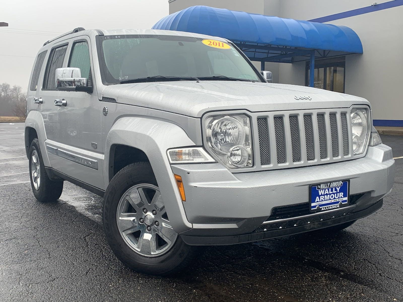 PRE-OWNED 2011 JEEP LIBERTY WITH NAVIGATION & 4WD