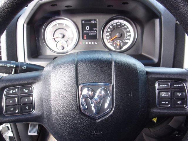 Used 2014 Ram 1500 4WD Quad Cab 140.5 SLT