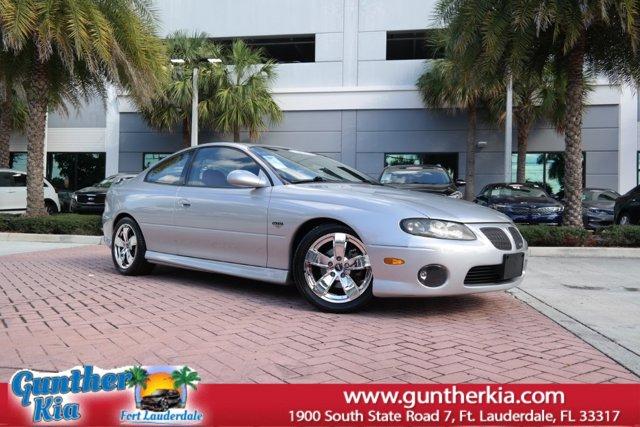 2004 Pontiac GTO 2dr Cpe QUICKSILVER METALLIC CD Player
