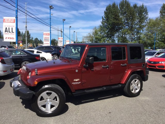 2009 Jeep Wrangler Unlimited 4WD 4dr Sahara RED ROCK CRYSTAL