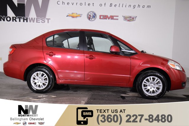 2012 Suzuki SX4 4dr Sdn CVT LE Popular FWD RED