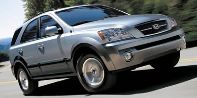 2006 Kia Sorento LX Body-color bumpers  Black mesh grille insert wchrome surround  Multi-reflect